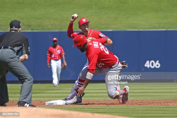 Trea Turner of the Washington Nationals gets Dexter Fowler of the St Louis Cardinals out at second base but can not turn the double play during a...