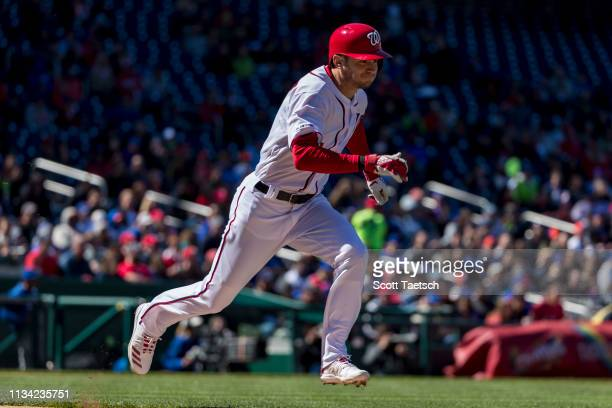 Trea Turner of the Washington Nationals grounds into a force out against the New York Mets during the fifth inning at Nationals Park on March 31 2019...