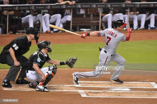Trea Turner of the Washington Nationals hits a double in the first inning against the Miami Marlins at Marlins Park on July 27 2018 in Miami Florida