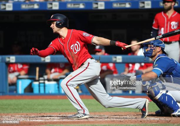 Trea Turner of the Washington Nationals hits a double in the sixth inning during MLB game action against the Toronto Blue Jays at Rogers Centre on...