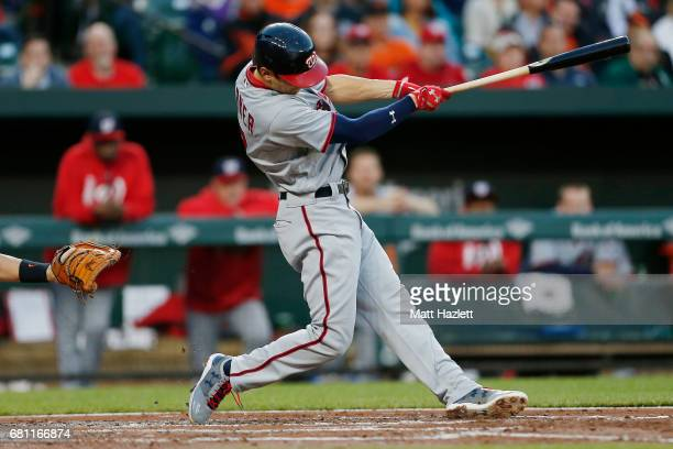 Trea Turner of the Washington Nationals hits a single against the Baltimore Orioles during the third inning at Oriole Park at Camden Yards on May 9...