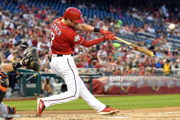 Trea Turner of the Washington Nationals hits a three run home run in the third inning during a baseball game against the Miami Marlins at Nationals...