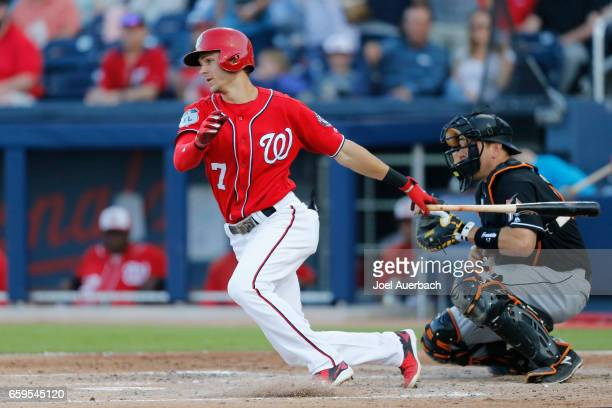 Trea Turner of the Washington Nationals hits the ball against the Miami Marlins during a spring training game at The Ballpark of the Palm Beaches on...
