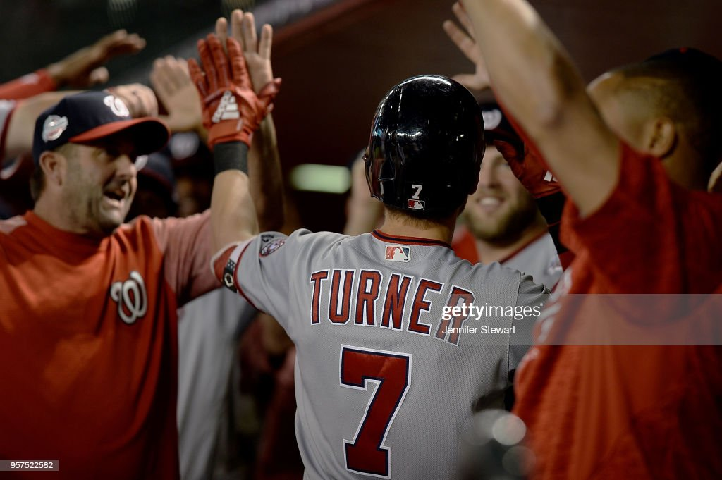 Trea Turner #7 of the Washington Nationals is congratulated after hitting a solo home run in the first inning of the MLB game against the Arizona Diamondbacks at Chase Field on May 11, 2018 in Phoenix, Arizona.