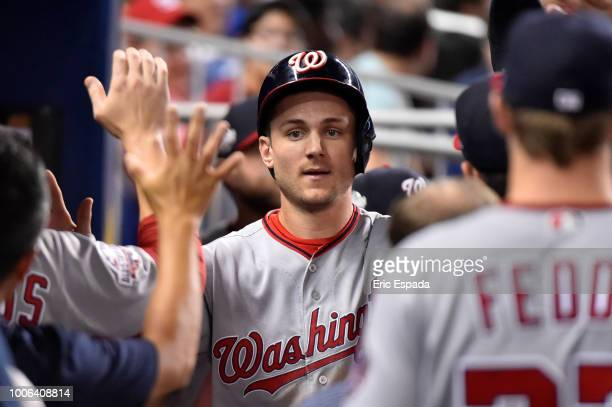 Trea Turner of the Washington Nationals is congratulated by teammates after scoring in the eighth inning against the Miami Marlins at Marlins Park on...