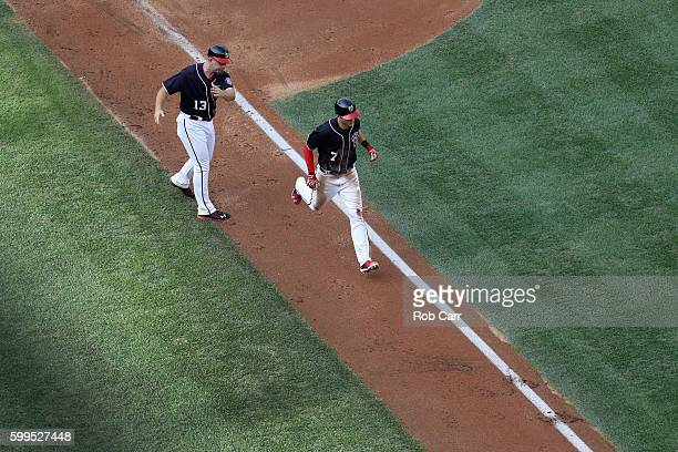 Trea Turner of the Washington Nationals is congratulated by third base coach Bob Henley after hitting a two RBI home run against the Atlanta Braves...