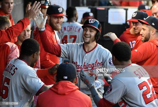 Trea Turner of the Washington Nationals is greeted by his teammates after hitting a home run against the Chicago White Sox during the fifth inning at...