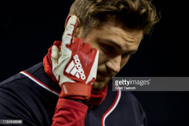 Trea Turner of the Washington Nationals leaves the field after being hit in the finger by a pitch against the Philadelphia Phillies during the first...