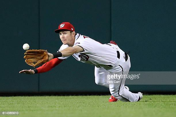 Trea Turner of the Washington Nationals makes a catch for the first out of the first inning against the Los Angeles Dodgers during game five of the...
