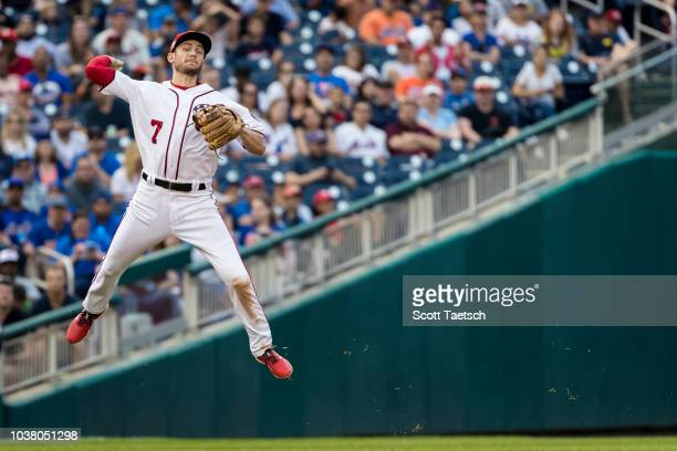 Trea Turner of the Washington Nationals makes a leaping throw to first to retire Kevin Plawecki of the New York Mets not pictured during the seventh...