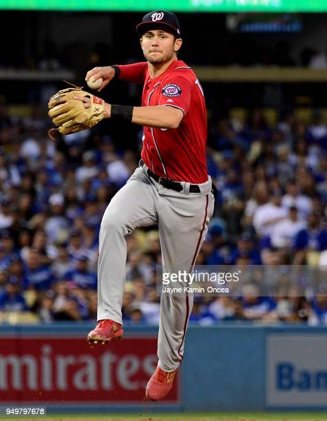 Trea Turner of the Washington Nationals makes a play and throws out Matt Kemp of the Los Angeles Dodgers at first base in the fifth inning of the...
