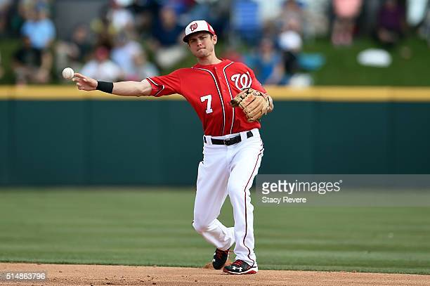 Trea Turner of the Washington Nationals makes a throw to first base during the fourth inning of a spring training game against the New York Mets at...