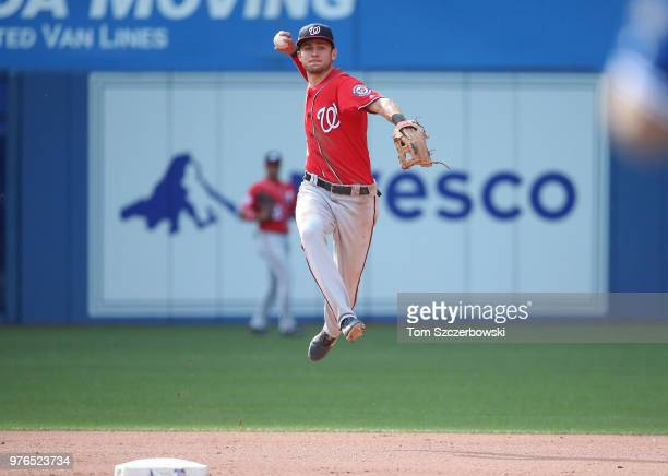 Trea Turner of the Washington Nationals makes the play and throws out the baserunner in the seventh inning during MLB game action against the Toronto...