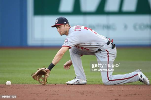 Trea Turner of the Washington Nationals makes the play on a grounder to shortstop and proceeds to throw out the baserunner in the second inning...