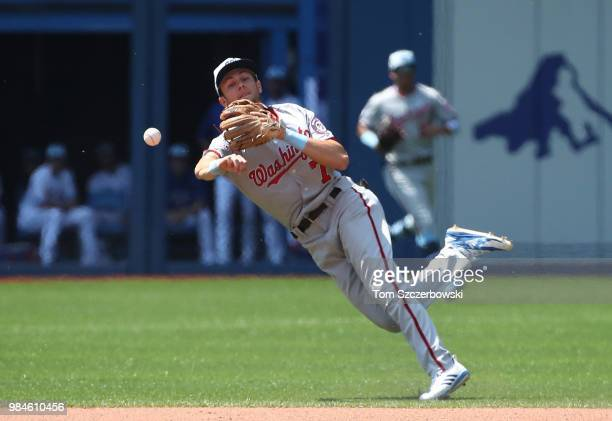 Trea Turner of the Washington Nationals makes the throw but cannot throw out Kendrys Morales of the Toronto Blue Jays as he hits an infield RBI...