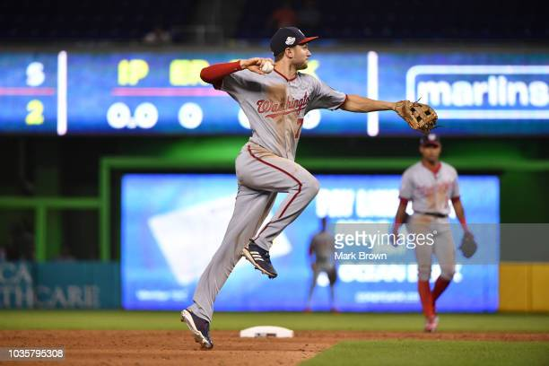 Trea Turner of the Washington Nationals makes the throw to first base in the ninth inning against the Miami Marlins at Marlins Park on September 18...