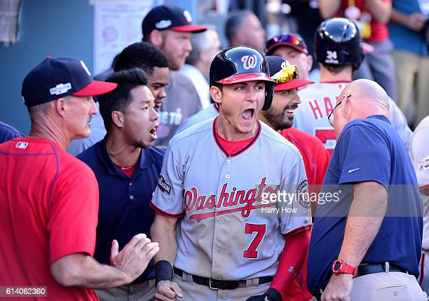 Trea Turner of the Washington Nationals reacts after scoring on a two RBI single hit by Daniel Murphy in the seventh inning against the Los Angeles...