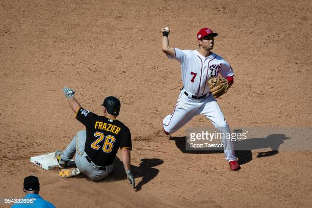 Trea Turner of the Washington Nationals retires Adam Frazier of the Pittsburgh Pirates at second base during the eighth inning at Nationals Park on...