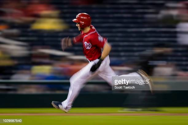 Trea Turner of the Washington Nationals rounds third before scoring against the Chicago Cubs during the seventh inning of game two of a doubleheader...