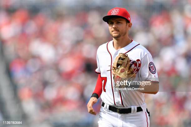 Trea Turner of the Washington Nationals runs back to the dugout after the top of the seventh inning against the New York Mets at Nationals Park on...