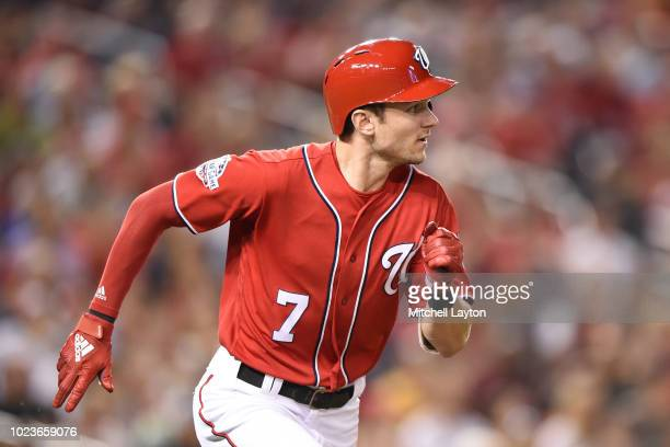 Trea Turner of the Washington Nationals runs to first base during a baseball game against the Miami Marlins at Nationals Park on August 18 2018 in...