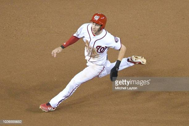 Trea Turner of the Washington Nationals runs to third base during a baseball game against the Philadelphia Phillies at Nationals Park on August 22...