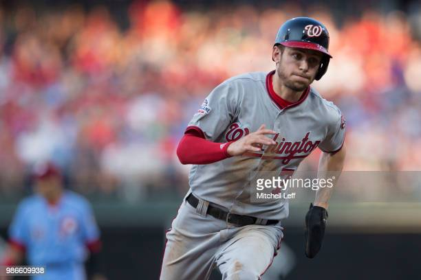 Trea Turner of the Washington Nationals runs to third on his way to scoring a run in the top of the second inning against the Philadelphia Phillies...