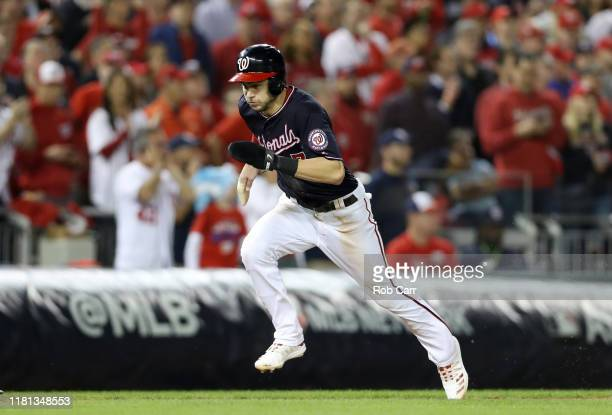 Trea Turner of the Washington Nationals scores a run in the first inning against the St. Louis Cardinals during game four of the National League...