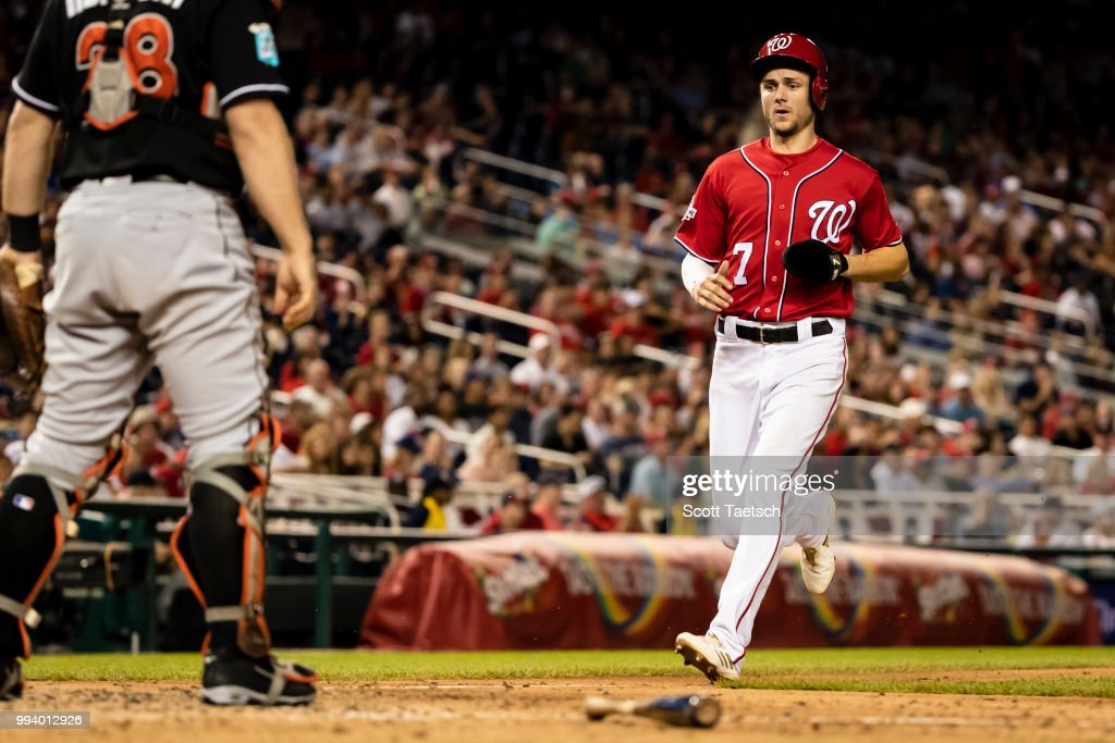 Trea Turner #7 of the Washington Nationals scores against the Miami Marlins during the seventh inning at Nationals Park on July 07, 2018 in Washington, DC.