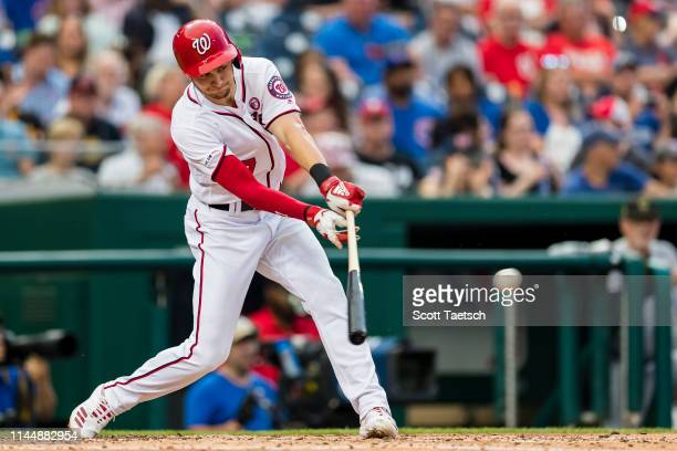 Trea Turner of the Washington Nationals singles against the Chicago Cubs during the third inning at Nationals Park on May 18 2019 in Washington DC