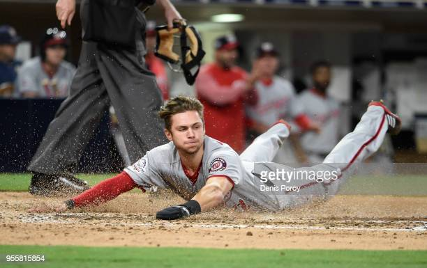Trea Turner of the Washington Nationals slides as he scores during the sixth inning of a baseball game against the San Diego Padres at PETCO Park on...
