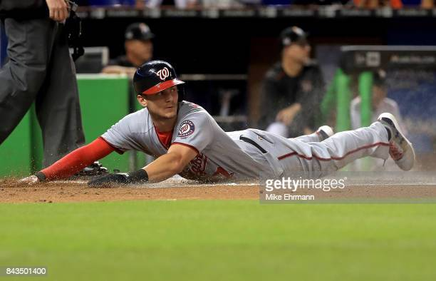 Trea Turner of the Washington Nationals slides home in the first inning during a game against the Miami Marlins at Marlins Park on September 6 2017...