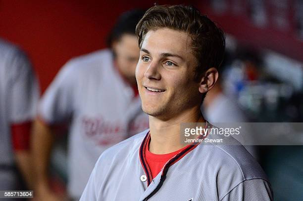 Trea Turner of the Washington Nationals smiles in the dugout after hitting a solo home run against the Arizona Diamondbacks during the third inning...