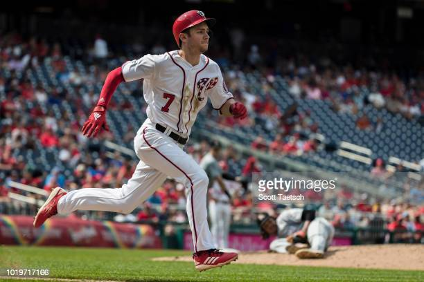 Trea Turner of the Washington Nationals sprints to first against the Miami Marlins during the sixth inning at Nationals Park on August 19 2018 in...