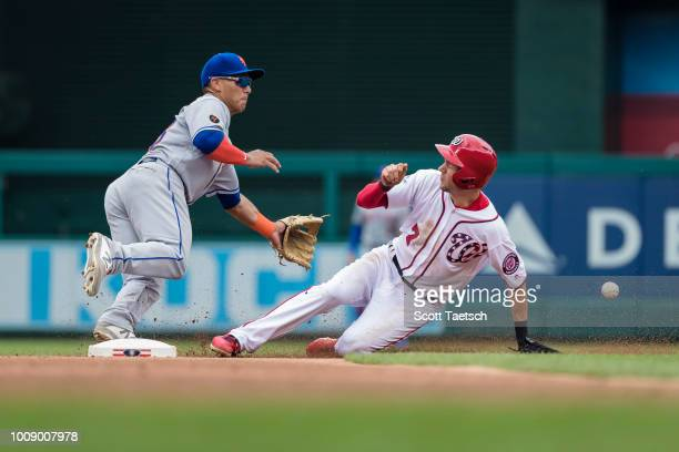 Trea Turner of the Washington Nationals steals second base against Phillip Evans of the New York Mets during the first inning at Nationals Park on...