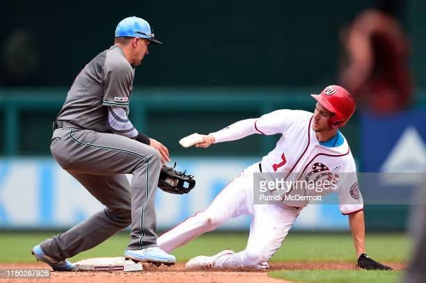 Trea Turner of the Washington Nationals steals second base against Nick Ahmed of the Arizona Diamondbacks in the second inning at Nationals Park on...