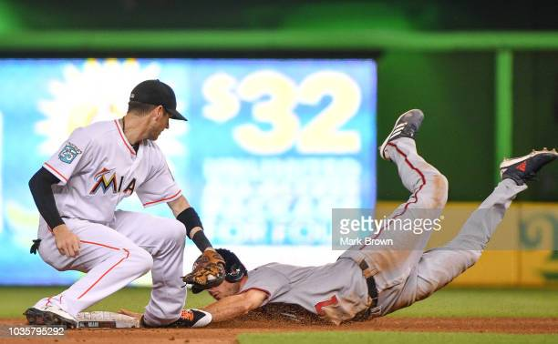 Trea Turner of the Washington Nationals steals second base in the sixth inning during the game between the Miami Marlins and the Washington Nationals...