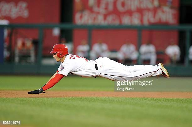 Trea Turner of the Washington Nationals steals second base in the first inning against the New York Mets at Nationals Park on September 12 2016 in...