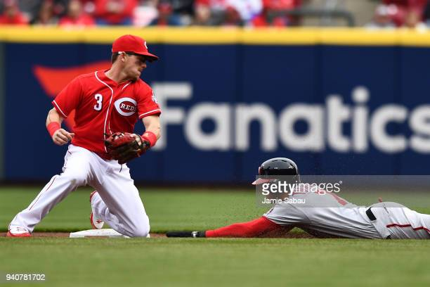 Trea Turner of the Washington Nationals steals second base in the first inning as Scooter Gennett of the Cincinnati Reds attempts the tag at Great...