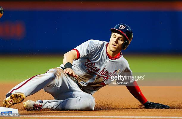 Trea Turner of the Washington Nationals steals third base in the first inning against the New York Mets at Citi Field on September 2 2016 in the...