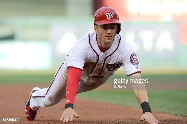 Trea Turner of the Washington Nationals steals third base in the first inning against the Chicago Cubs at Nationals Park on June 27 2017 in...