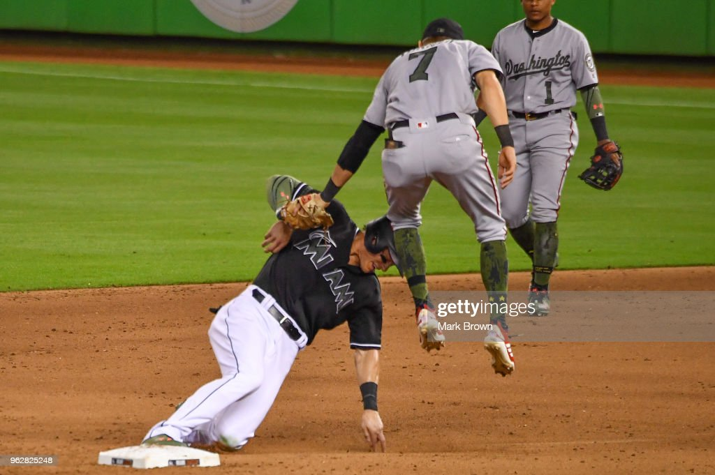 Trea Turner #7 of the Washington Nationals tags out Derek Dietrich #32 of the Miami Marlins during the sixth inning during the game between the Miami Marlins and the Washington Nationals at Marlins Park on May 26, 2018 in Miami, Florida.