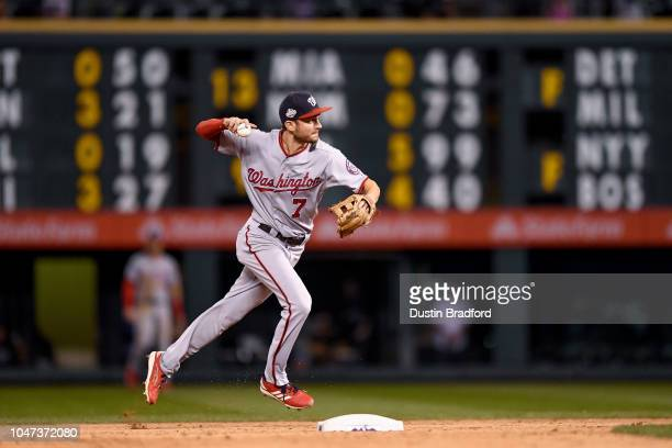 Trea Turner of the Washington Nationals throws to first base for a force out against the Colorado Rockies at Coors Field on September 29 2018 in...