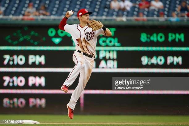 Trea Turner of the Washington Nationals turns a double play in the eighth inning against the Atlanta Braves at Nationals Park on August 7 2018 in...