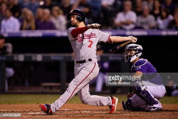 Trea Turner of the Washington Nationals watches the flight of a second inning tworun homerun against the Colorado Rockies at Coors Field on September...