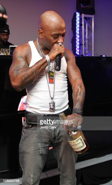 Treach of Naughty By Nature pours a tribute shot of Hennessy on his tatoo of Tupac Shakur during a performance at the Big Game Old School Kickoff...