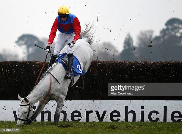 G Treacy is unseated from Sizing Sahara at Fontwell Park on December 6 2016 in Fontwell England