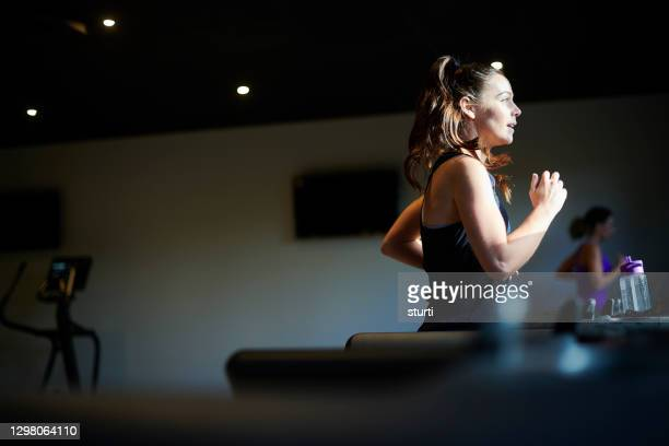 treadmill workout - dark stock pictures, royalty-free photos & images