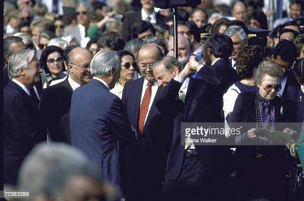 Treas Secretary James Baker NCS advisor John Poindexter and WH chief of Staff Don Regan during WH ceremony
