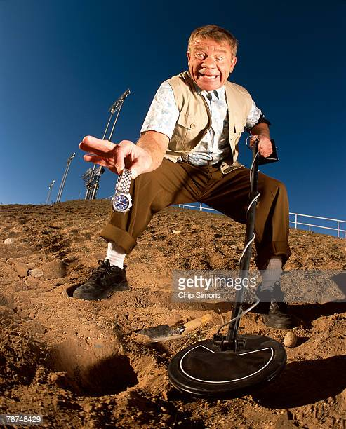 treasure hunter with watch - exceed and excel stock pictures, royalty-free photos & images